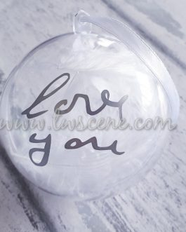 Clear bauble with handwriting message filled with feathers and rose